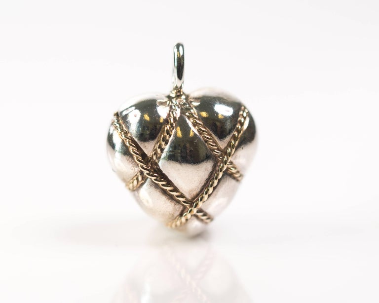 Tiffany and co sterling silver 14 karat yellow gold puffed heart tiffany and co quilted puffed heart pendant sterling silver 14 karat yellow gold features aloadofball Images