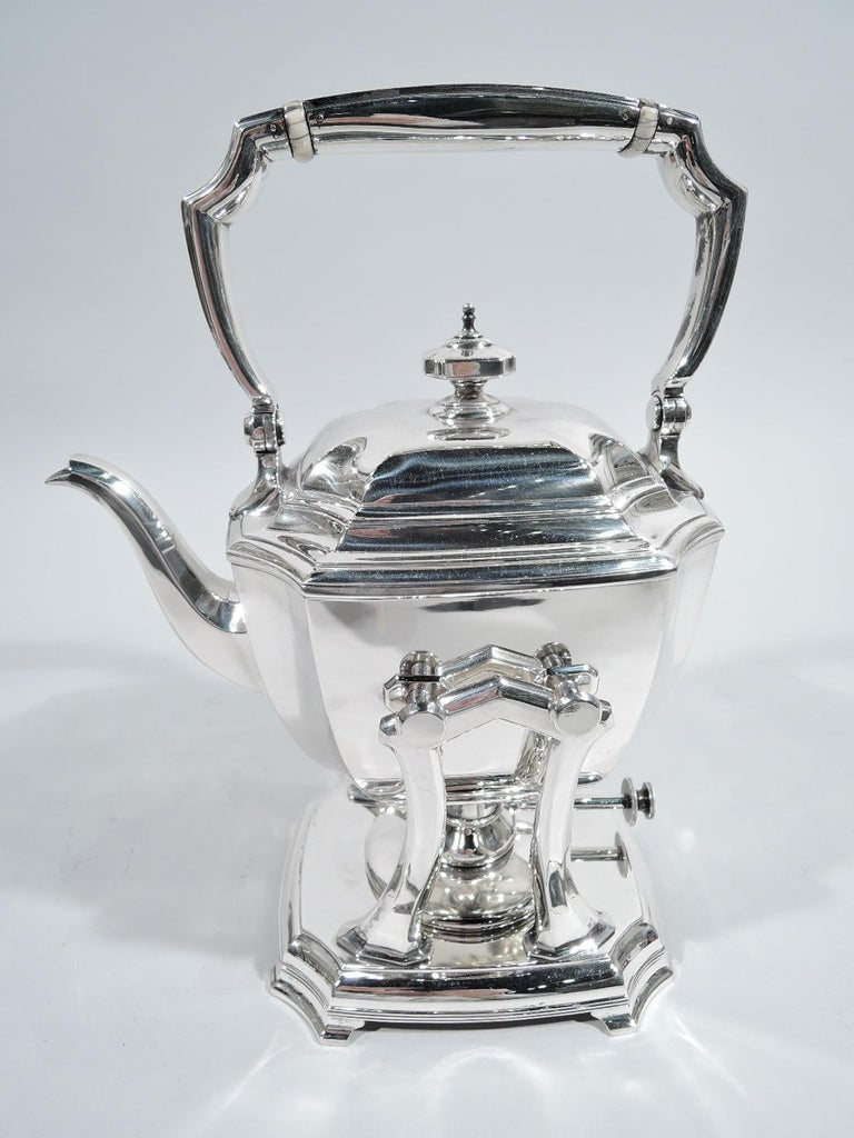Hampton sterling silver coffee and tea set. Made by Tiffany & Co. in New York, ca 1925. This set comprises hot water kettle on stand, coffeepot, teapot, creamer, sugar, and waste bowl on tray.  Rectilinear with curved sides, concave corners, and