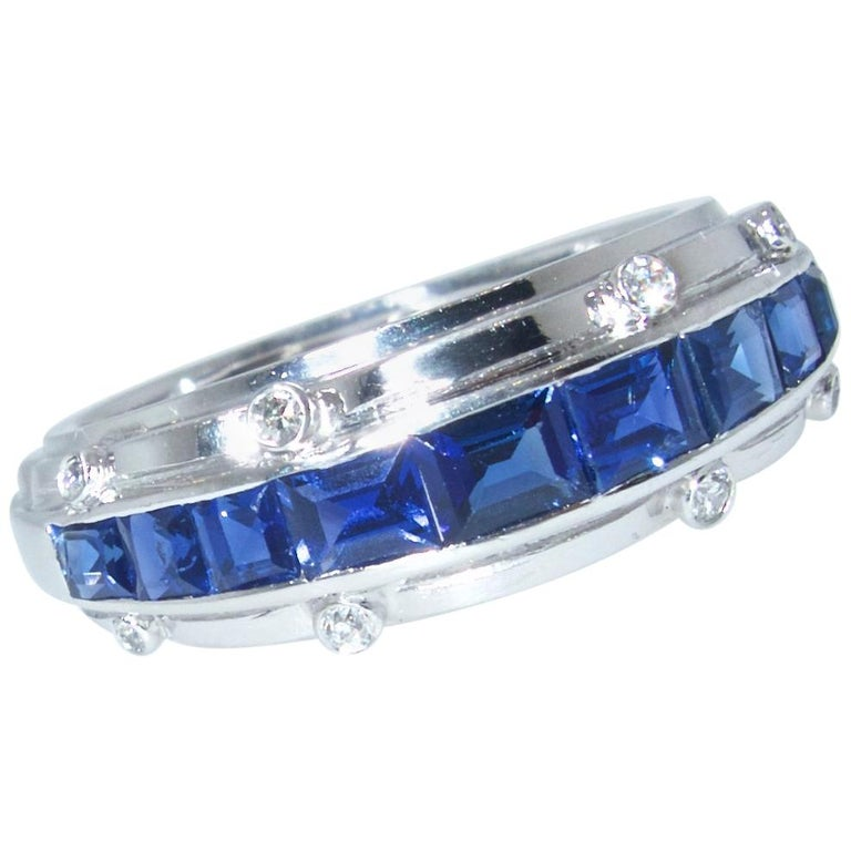 Tiffany Diamond and fine deep blue natural sapphire ring.  Hand made by the famous firm of Tiffany & Co., this platinum ring centers well match fancy cut natural vivid blue unheated sapphires.  Accenting these Burma color stones are small diamonds