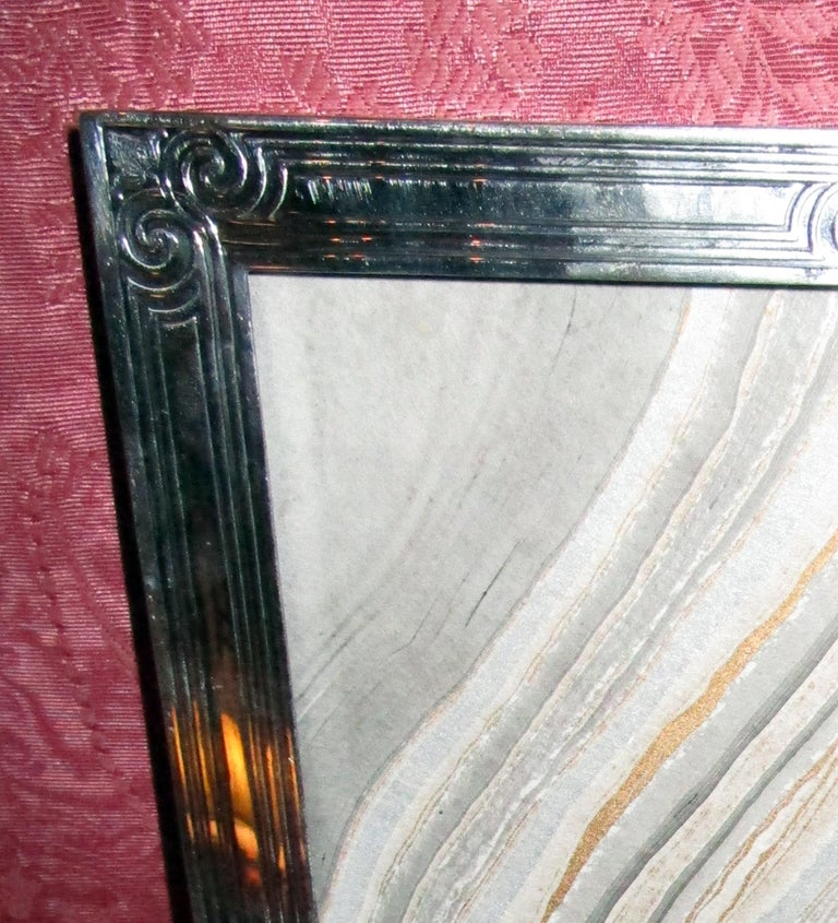 Art Deco sterling silver picture frame made by Tiffany & Co., New York. Rectangular window with acid-etched surround and sides. Marked Tiffany & Co. 16544S (pattern number), Makers 3002, sterling silver 925/1000 M (directors letter 1907-47.) Two