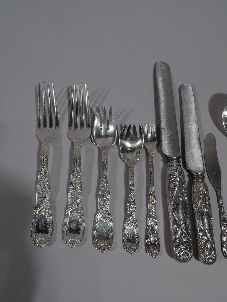 Chrysanthemum sterling silver dinner set. Made by Tiffany & Co. in New York, circa 1890.  This set comprises 145 pieces (dimensions in inches): Forks: 24 dinner forks (7 1/2), 12 salad/terrapin forks (6 3/8), 12 seafood forks (6), and 12 ice cream