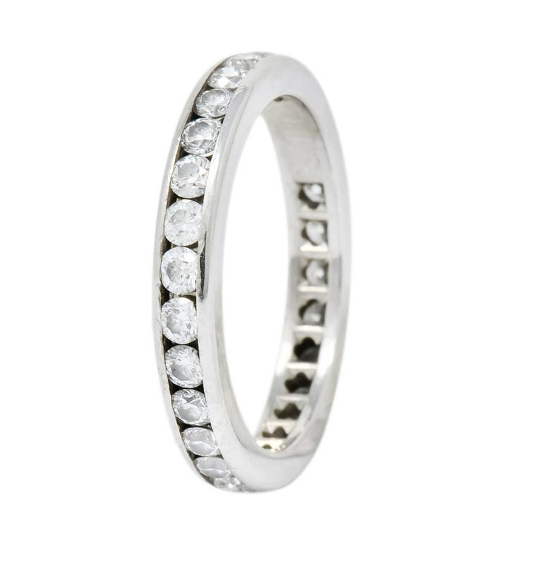 Eternity style band with round brilliant cut diamonds weighing approximately 1.05 carats total, G/H color and VS clarity  Completely channel set with diamonds and high polished walls  Fully signed Tiffany & Co.  Stamped PT950 for platinum  Ring