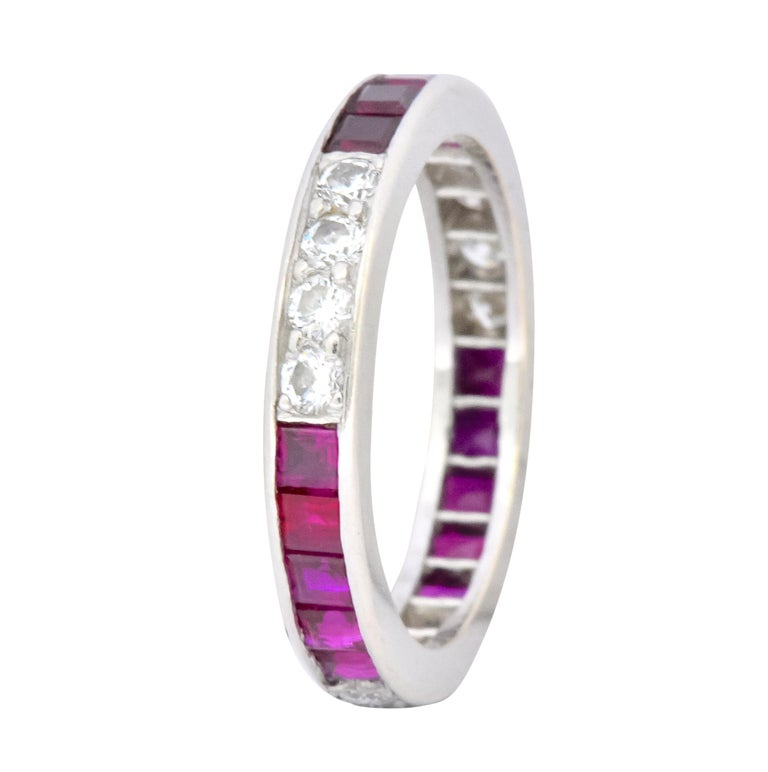 Entire surface set with alternating groups of rubies and diamonds   Twelve bead set round brilliant cut diamonds weighing approximately 0.36 carat, G/H color and VS clarity  Fifteen channel set, square calibré cut rubies, weighing approximately 0.90