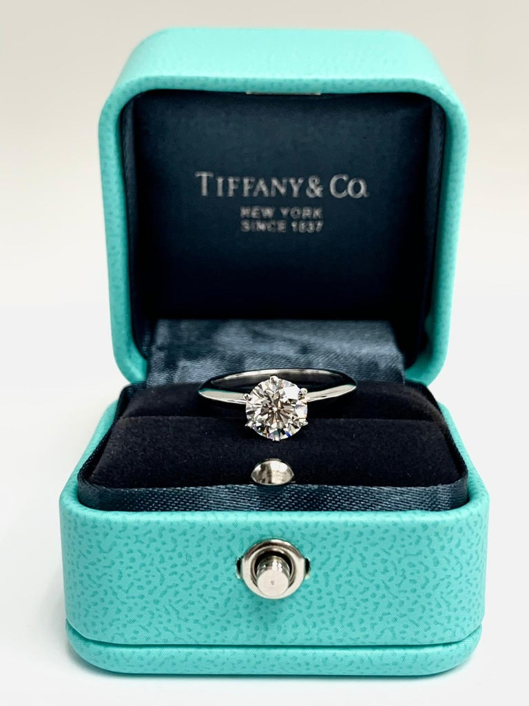 Classic Tiffany & Co Round Brilliant cut diamond set as a Solitaire Engagement Ring featuring a 1.39 ct Center graded with a G color and Internally Flawless (IF) clarity grade, Triple Excellent Cut. Finely crafted in a 6 prong Platinum Mounting. (