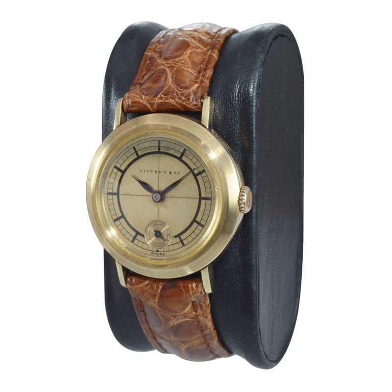 FACTORY / HOUSE: Tiffany & Co. STYLE / REFERENCE: Art Deco METAL / MATERIAL: 14Kt Yellow Gold CIRCA / YEAR: 1930's DIMENSIONS / SIZE: 37mm x 31mm MOVEMENT / CALIBER: Manual Winding / 15 Jewels  DIAL / HANDS: Original Gold Dial with engraved Baton