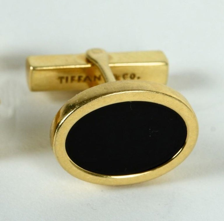 Tiffany & Co. 14 Karat Yellow Gold and Black Onyx Vintage Cufflinks.  N.P. Trent has been a respected name in antiques for over 30 years with a large collection of antique and vintage jewelry.