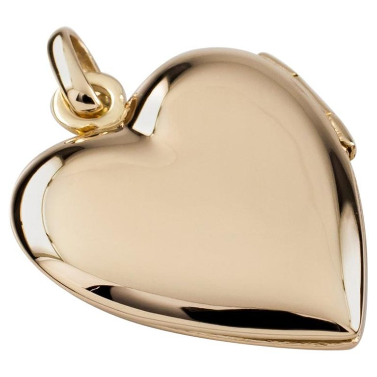 8b96c746e Tiffany and Co. 14 Karat Yellow Gold Heart Locket Pendant at 1stdibs