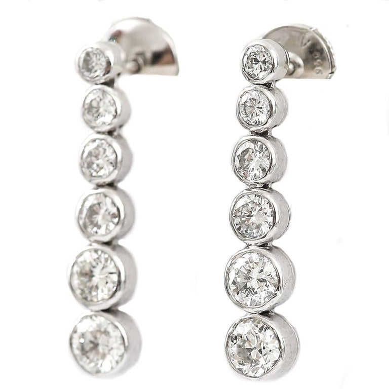 A super pair of earrings by Tiffany & Co from their Jazz Collection these pre-loved platinum diamond drop earrings have a total diamond weight of 1.42ct.   Made with twelve graduated drops, utilizing superb sparkling brilliant cut diamonds, these