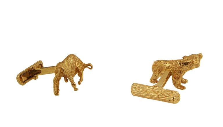 TIFFANY & CO. 14K YELLOW GOLD BEAR AND BULL CUFFLINKS.   Mint condition 1 Bull and 1 Bear cufflink with Toggle Backs Crafted in 14k Yellow Gold, Richly Textured and Intricately Detailed Cufflinks measure approximately 22 x 13 mm Cufflinks are
