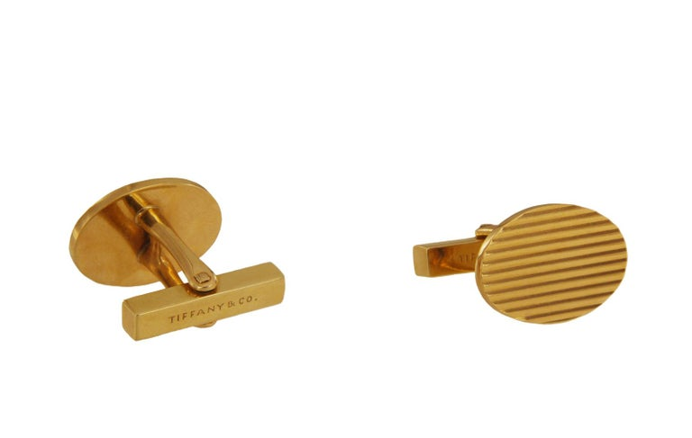 """TIFFANY & CO. 14K YELLOW GOLD MENS CUFFLINKS.  Mint condition 14k Yellow Gold Dimension: 0.5x0.7"""" Weight: 14.8 gr  *Comes with Tiffany pouch."""