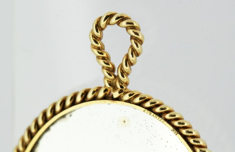 Antique Tiffany & Co 14kt white and yellow gold mirror, with a bale, which can be used as a pendant aswell. Designer : Tiffany & Co Made in USA circa 1940's Fully hallmarked.  Approx Dimensions -  Size : 8 x 5.3 x 0.4 cm Weight : 41 grams  Condition