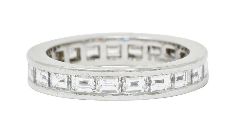 Eternity style band ring channel set fully around by twenty-one baguette cut diamonds  Weighing in total 1.68 carats, E/F color with VVS to VS clarity  Signed Tiffany & Co.  Tested as platinum  Ring Size: 5 & not sizable  Measures: 3.5 mm wide and