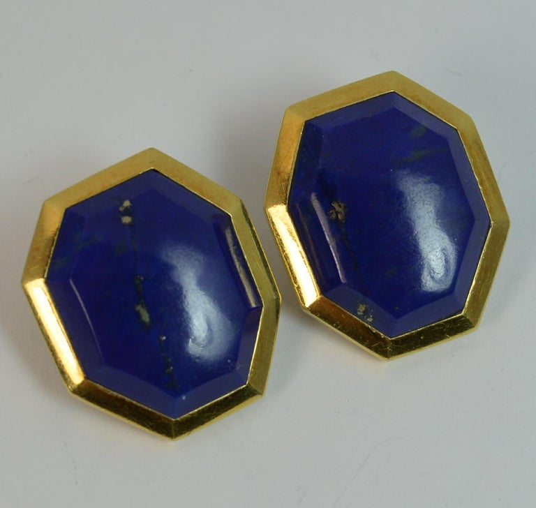 A pair of TIFFANY and CO earrings.  Solid 18 carat yellow gold examples.  Each set with a single eight sided lapis lazuli.  Vinatge pair circa 1950 - 60.   CONDITION ; Excellent. Well set stones. Good, well fitted backs to earrings. Cleaned. No box.