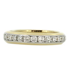 A Tiffany & Co. 18ct Yellow Gold and Platinum Lucida Diamond Eternity Ring