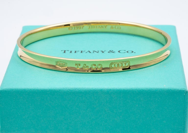 Tiffany & Co. slip on bangle bracelet finely crafted in 18 karat yellow gold. Pertaining to the Tiffany & Co.