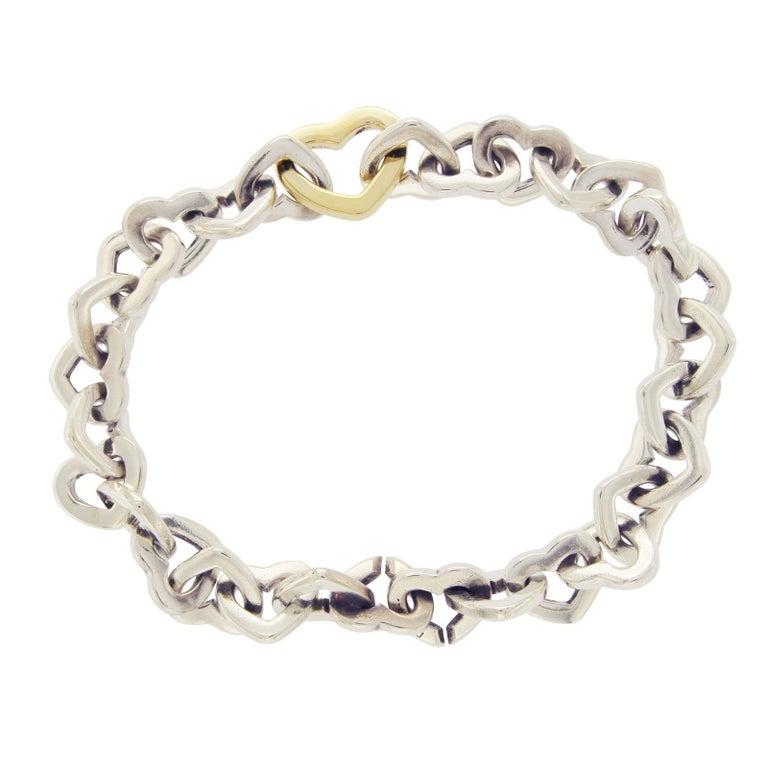 06f069390 Tiffany & Co. 18 Karat Gold and Sterling Silver Heart Link Bracelet For Sale