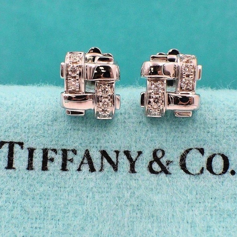 Tiffany & Co. Style:  Vannerie Basket Weave Earrings Metal: White Gold 18 KT Total Carat Weight:  0.25 TCW Diamond Shape:  Round Brilliant Diamonds Diamond Color & Clarity:   G / VS Size:  8 MM X 9 MM Hallmark:  Tiffany&Co. ©2002 750 ITALY (on