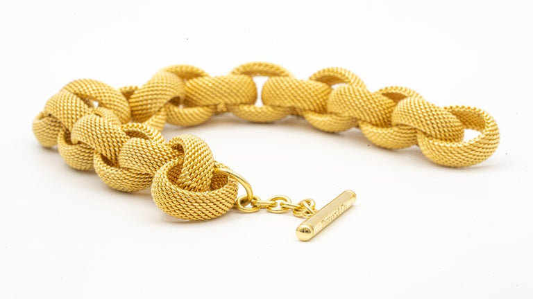Tiffany & Co. Gold Link Toggle Bracelet finely crafted in 18 Karat yellow gold , comprised of interlocking woven mesh oval links. Matte finish mixed with high polished gold. Hallmarks: Tiffany & Co .  Weight: 77.7 grams.  Length: 8.5 inches with