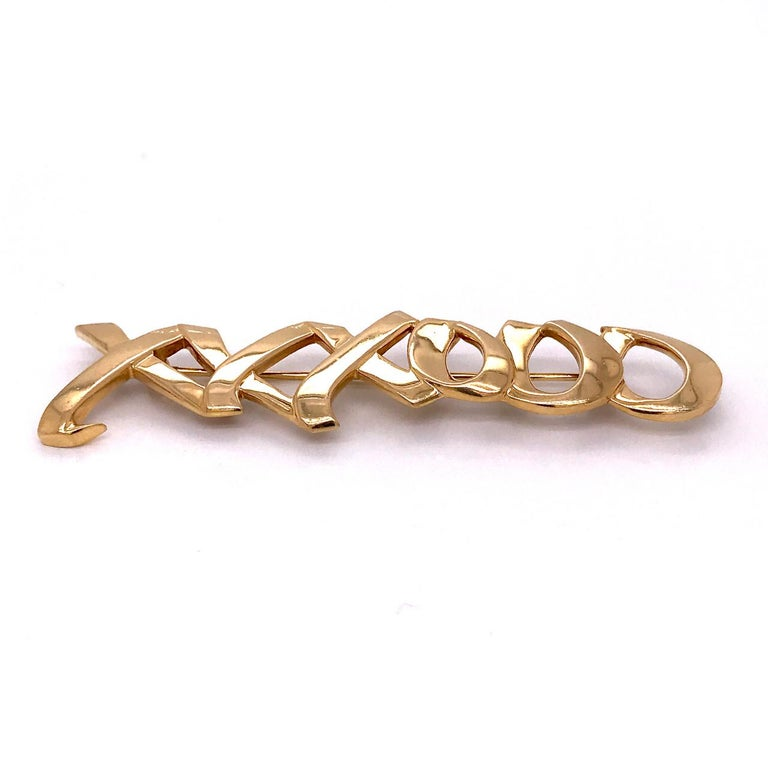 A very fine Graffiti Love & Kisses brooch by Paloma Picasso for Tiffany & Co.  In 18k yellow gold with the XXXOOO love and kisses motif.  Simply top shelf design by the world's premier retailer!  Marked 750 for 18k gold fineness, Tiffany & Co., and