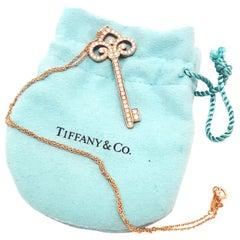 Tiffany & Co. 18 Karat Rose Gold Diamond Fleur-de-Lis Diamond Key Necklace