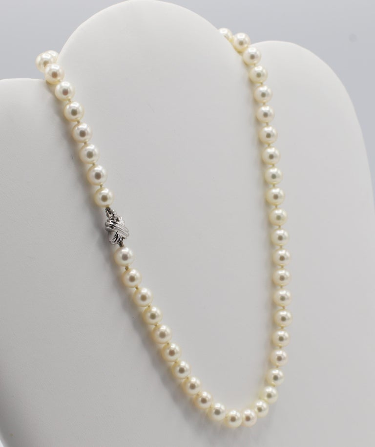 Tiffany & Co. 18 Karat White Gold Akoya Cultured Pearl 7mm Signature X Necklace  Metal: 18k white gold clasp  Weight: 30.5 grams Length: 16 inches  Pearls: Akoya cultured 7mm pearls