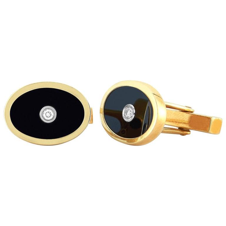 Tiffany & Co. 18 Karat Yellow Gold 0.10 Carat Diamond and Onyx Oval Cufflinks
