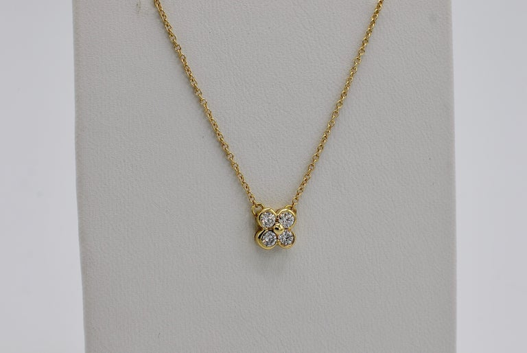Tiffany & Co. 18 Karat Yellow Gold .21 Carat Diamond Bezel Set Cluster Pendant Necklace 16 inch chain  Metal: 18k yellow gold Weight: 2.17 grams Diamonds: .21 CTW F-G VS Pendant diameter: 6.2MM Chain length: 16 inches