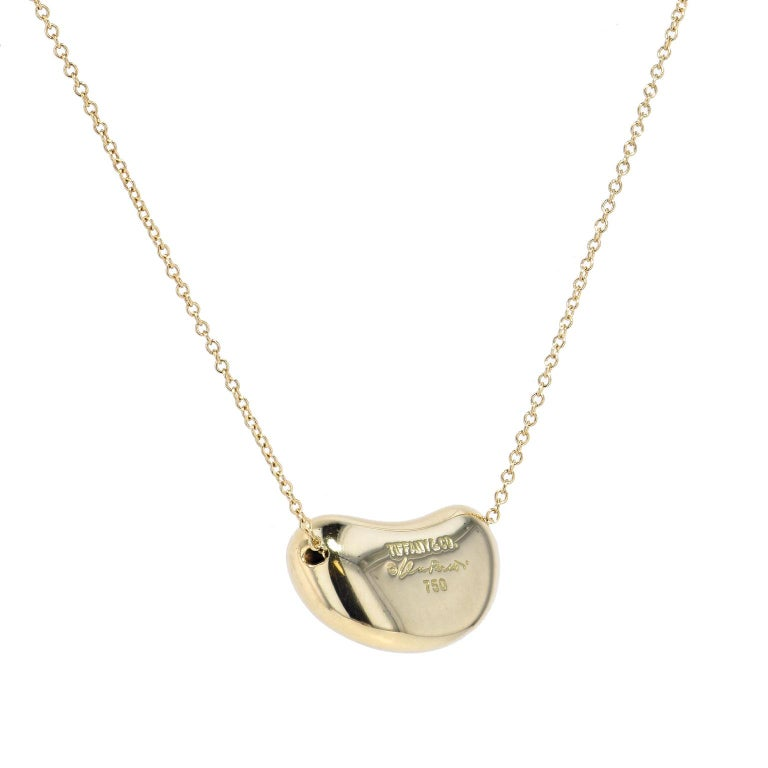 Tiffany & Co. 18 Karat Yellow Gold Bean Pendant Necklace In Excellent Condition For Sale In Miami, FL