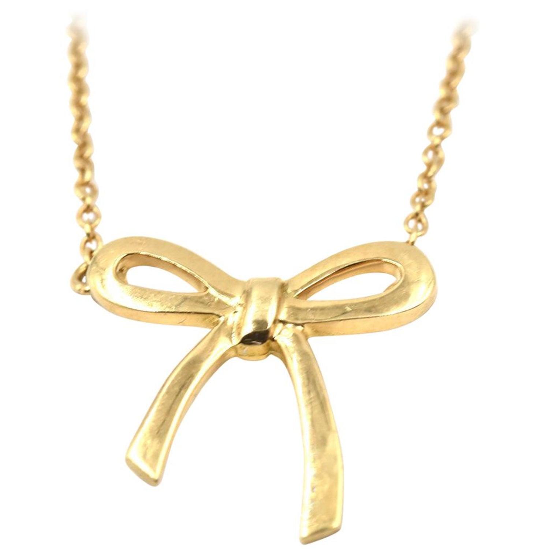 0fb07fb10 Tiffany and Co. 18 Karat Yellow Gold Bow Pendant Necklace at 1stdibs