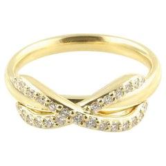 Tiffany & Co. 18 Karat Yellow Gold Diamond Infinity Ring with Box/Bag/ Booklet