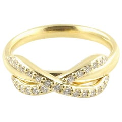 Tiffany & Co. 18 Karat Yellow Gold Diamond Infinity Ring with Box/Bag/ Booklet