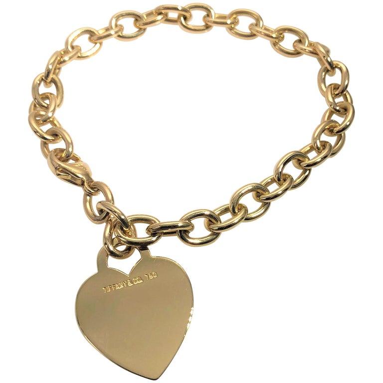 625515f2a Tiffany and Co. 18 Karat Yellow Gold Heart Tag Charm Bracelet at 1stdibs