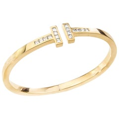 Tiffany & Co. 18 Karat Yellow Gold Ladies Bangle with Princess Cut Diamonds