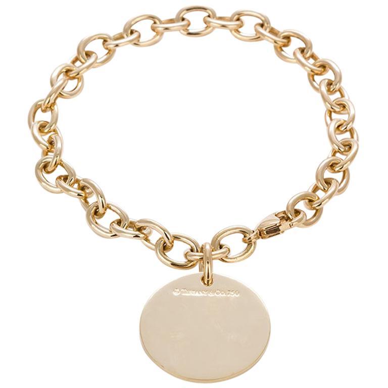 Tiffany & Co. 18 Karat Yellow Gold Round Charm Bracelet For Sale