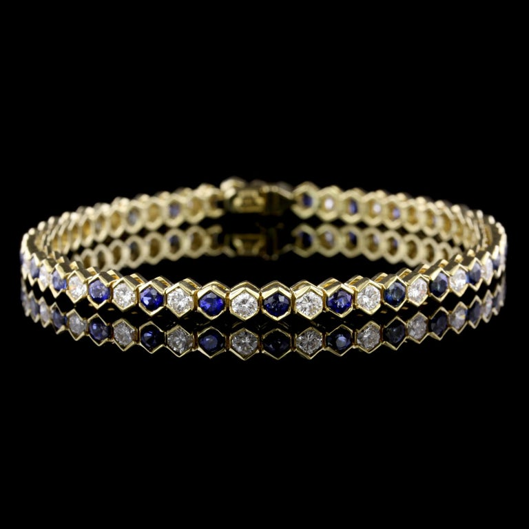 Tiffany & Co. 18K Yellow Gold Sapphire and Diamond Bracelet. The bracelet is set with 26 round cut sapphires, approx. total wt. 3.25cts., and 26 full cut diamonds, approx. total wt. 2.50cts., F-G color VS clarity, length 7