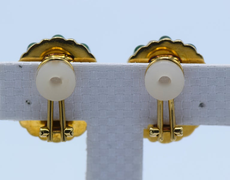 These Tiffany & Co clip on earrings are made of 18K Yellow Gold and striped with green enamel. Made in Italy, circa 1980, these earrings are a bold and colorful piece.