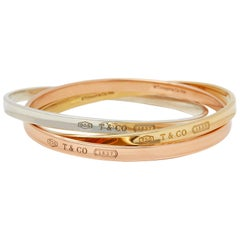 Tiffany & Co. 18 Karat Yellow, Rose Gold and Silver 1837 Bangle Bracelet