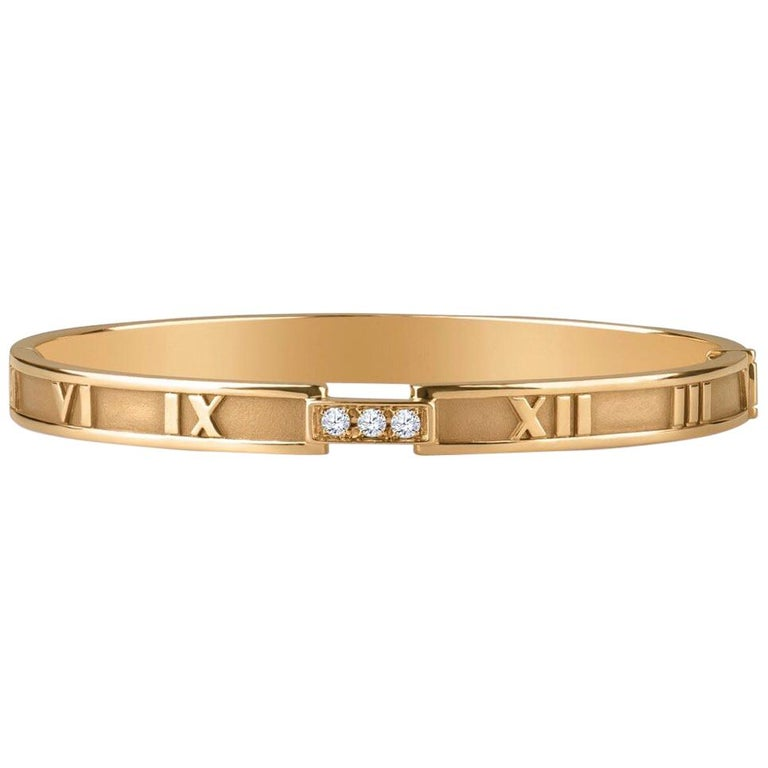Tiffany & Co. 18k Atlas Closed Hinged Bangle with 3 Round Diamonds, 0.15CTW 1