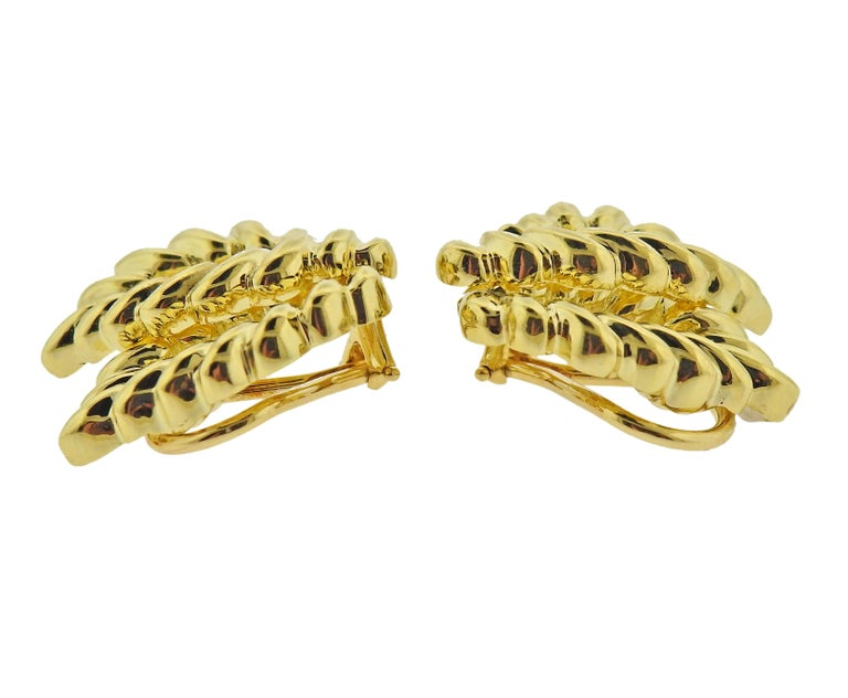 Pair of 18k gold earrings, measuring 24mm x 20mm. Marked: T & Co, 750. Weight - 16.4 grams.