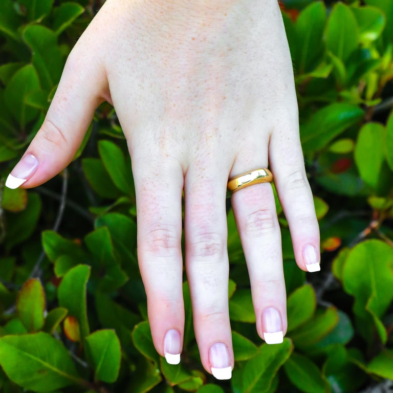 Coming from William David hand curated collection. This ring was made and designed by Tiffany + Co in Italy and has a unique curve in its design. It's made of 18K gold and has every hallmark to authenticate that it was made by Tiffany + Co.  •