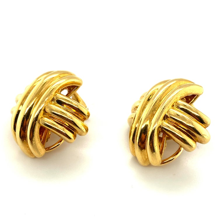 This pair of Tiffany & Co 18k gold Criss-Cross clip-on earrings from the Signature X Collection is one of the larger models of the