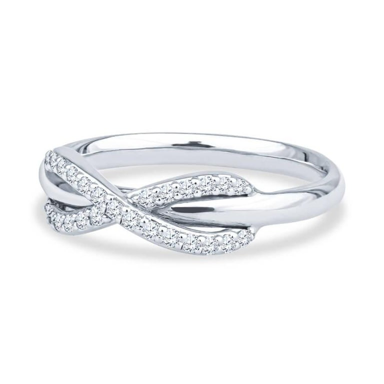 A beautiful and extremely elegant ring from the Tiffany & Co. Infinity Collection that is very feminine. It is crafted from 18k white gold and features the infinity symbol traced in pave diamonds with a total carat weight of .13. It is a size 5.5.