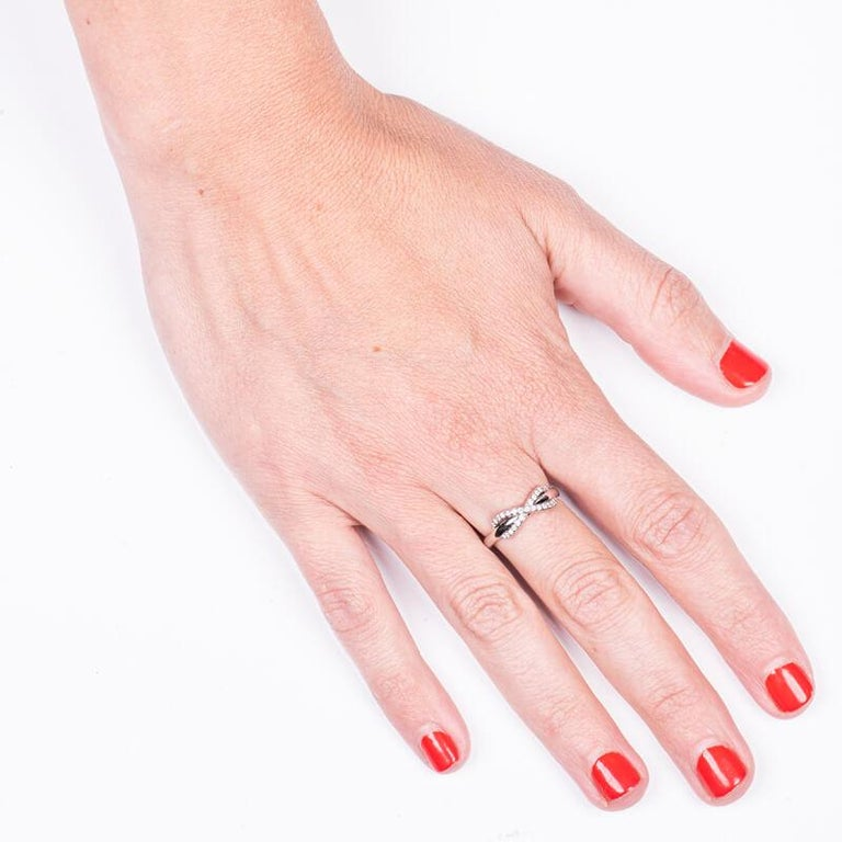 Women's or Men's Tiffany & Co. 18K White Gold .13ctw Diamond Infinity Ring For Sale