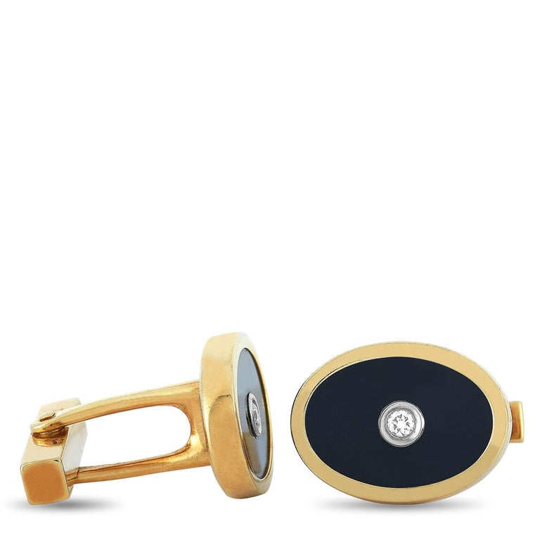 """These Tiffany & Co. cufflinks are made of 18K yellow gold and set with onyxes and two diamond stones that total 0.10 carats. The cufflinks measure 0.75"""" in length and 0.55"""" in width, and each of the two weighs 7.1 grams.    The pair is offered in"""