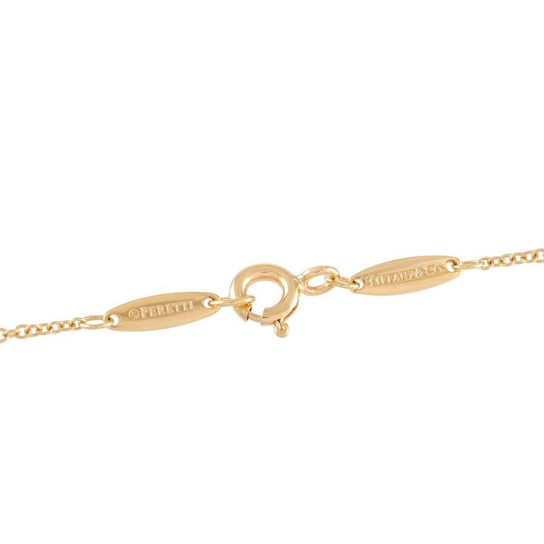 Round Cut Tiffany & Co. 18 Karat Yellow Gold 0.10 Carat Diamond Solitaire Pendant Necklace For Sale