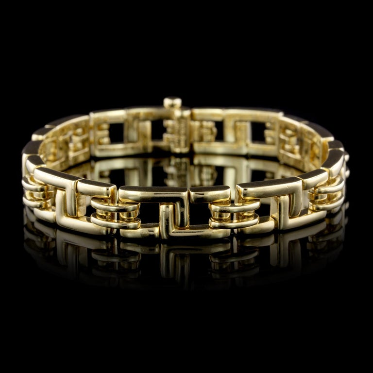 Tiffany & Co. 18K Yellow Gold Bracelet. The bracelet is designed with flexible fancy links, circa 2001, length 7 1/2