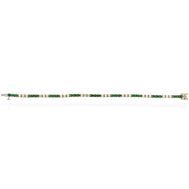 METAL TYPE: 18K Yellow Gold STONE WEIGHT: Diamond 1.70ct twd and Emerald 2.16ct twd TOTAL WEIGHT: 9.5g BRACELET LENGTH: 7