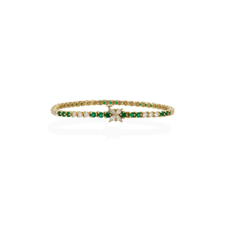 Women's Tiffany & Co. 18 Karat Yellow Gold Diamond and Emerald Tennis Bracelet For Sale