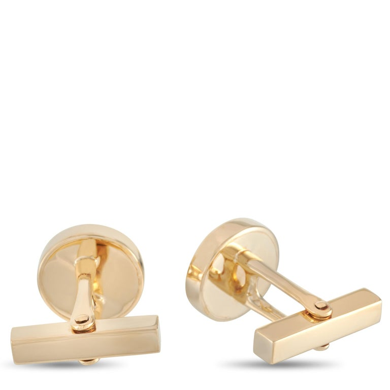 """These Tiffany & Co. cufflinks are made of 18K yellow gold and set with diamond and onyx stones. The cufflinks measure 0.57"""" in length and 0.57"""" in width, and each of the two weighs 7 grams.    The pair is offered in estate condition and includes a"""