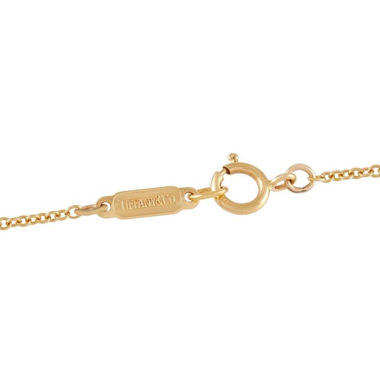 Round Cut Tiffany & Co. 18 Karat Yellow Gold Diamond Cross Pendant Necklace For Sale